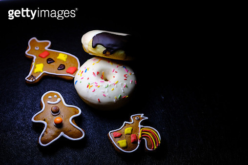 fresh donut and cookies  on black background - gettyimageskorea