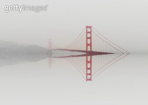 Mirror distortion effect of the Golden Gate bridge emerging from water. - gettyimageskorea