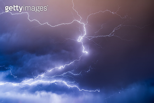 Lightning in the night sky during a thunderstorm - gettyimageskorea