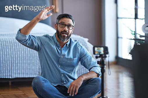 Male influencer recording for video blog from home - gettyimageskorea