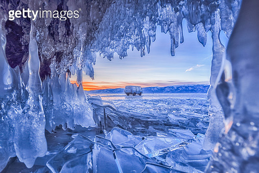 Ice cave at Baikal Lake in the sunset time with van. - gettyimageskorea