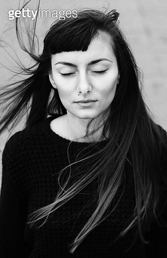 Portrait of woman closing her eyes, Sarajevo, Bosnia and Herzegovina - gettyimageskorea