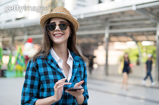 woman using smart phone during travel - gettyimageskorea