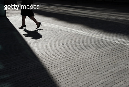 Low angle view of businessman walking - gettyimageskorea