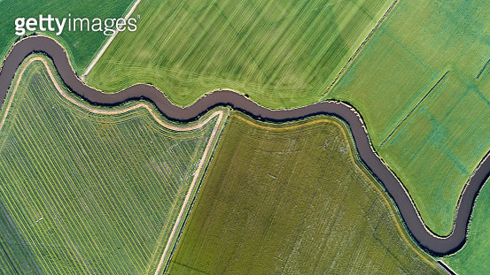 Small waterway finding it's way through cultivated Dutch landscape - gettyimageskorea