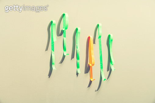 tape on the wall losing its grip, symbolizes a graph and fragile markets - gettyimageskorea