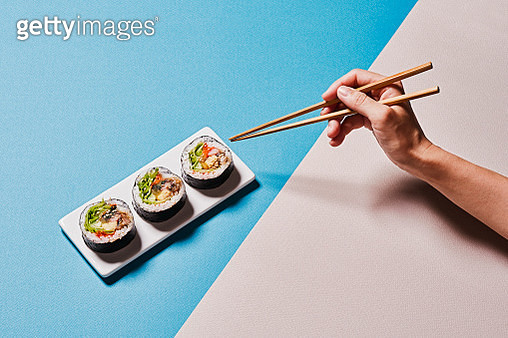 Gimbap is a Korean dish that is made by wrapping rice with seaweed. - gettyimageskorea