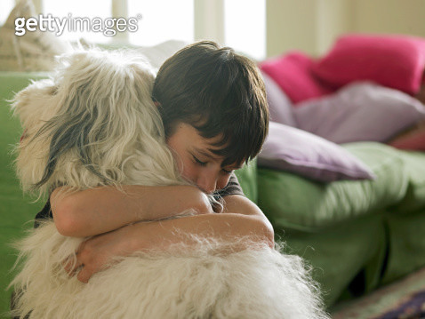 Boy hugging his dog - gettyimageskorea