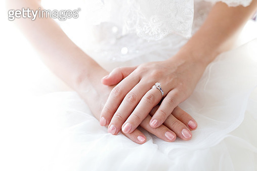 Midsection Of Bride Wearing Ring And Pink Nail Polish - gettyimageskorea
