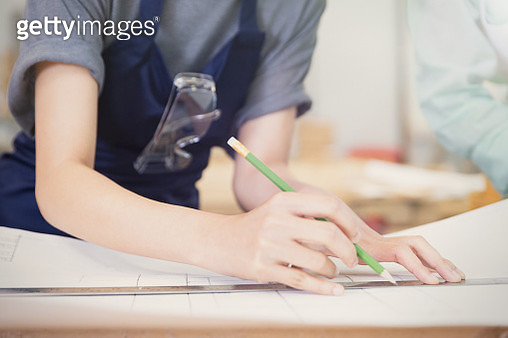 Carpenter drafting plans with pencil and ruler - gettyimageskorea