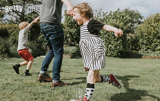 Kids running in a Garden - gettyimageskorea