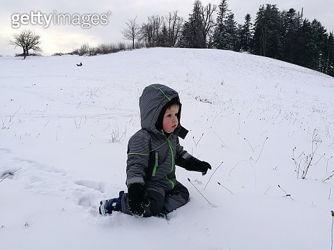 Boy Playing On Snow Field - gettyimageskorea