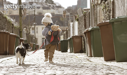 Young child walking down cobbled lane - gettyimageskorea