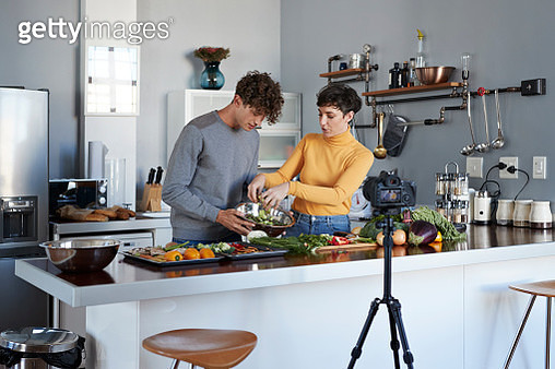 Vloggers making making video at home in stylish urban apartment - gettyimageskorea