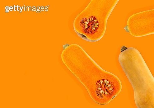 Butternut pumpkin isolated on orange background. Food concept, copy space - gettyimageskorea
