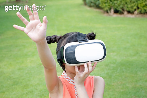 Little asian girl wearing virtual reality goggles - gettyimageskorea