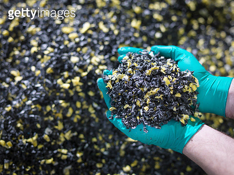 Worker holding recycled plastic in plastics factory, close up - gettyimageskorea