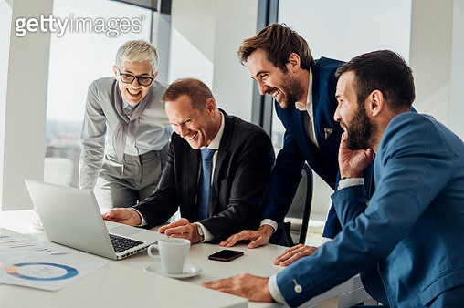 Business people looking at laptop - gettyimageskorea