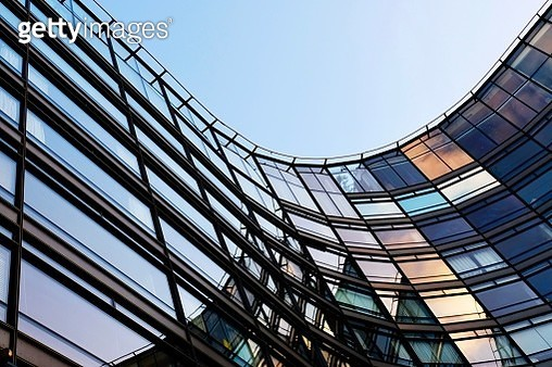Low angle view of colourful modern glass building - gettyimageskorea