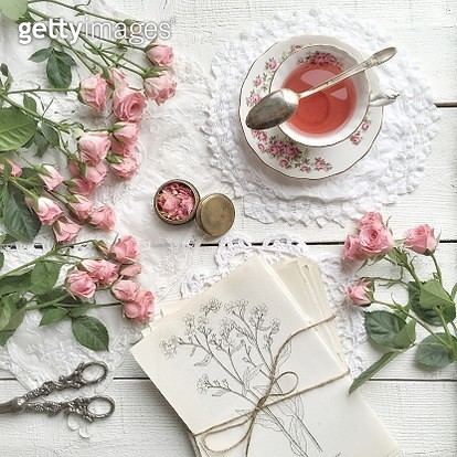 Pink roses and cup of tea - gettyimageskorea