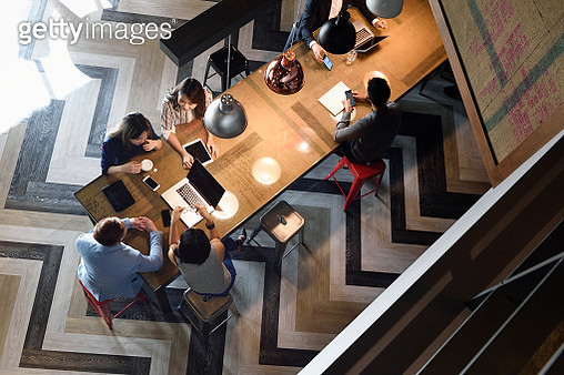 Young Chinese colleagues working together in a busy co-working space from above - gettyimageskorea