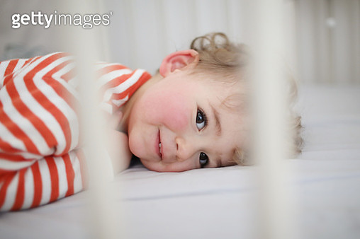 A 2 years old boy waking up from his nap in his bed - gettyimageskorea