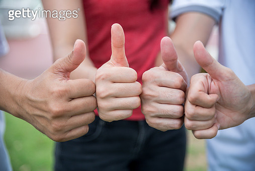 Cropped Image Of Friends Gesturing Thumbs Up - gettyimageskorea