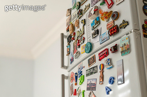 Lots of various souvenir magnets on the fridge in the kitchen - gettyimageskorea