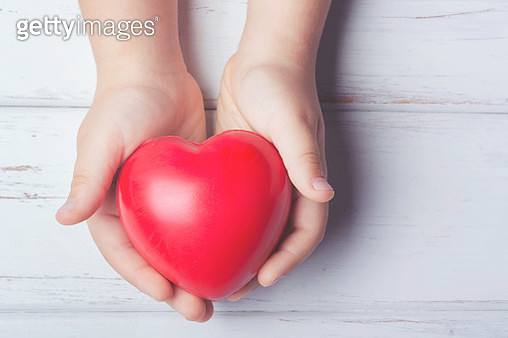 a heart in the hands of a child - gettyimageskorea