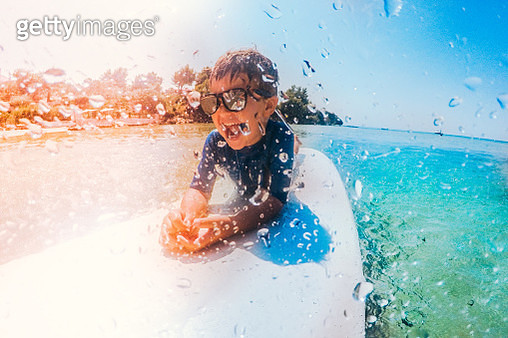 Little surfer boy - gettyimageskorea