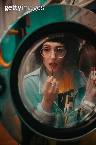 Reflection Of Woman Applying Lip Gloss In Mirror - gettyimageskorea