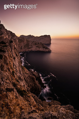 Mediterranean sea and rocky coastline of Mallorca at sunset. - gettyimageskorea