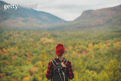 Female hiker surrounded by beautiful fall colors - gettyimageskorea