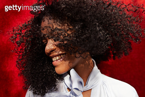 Close-up of woman with tousled hair - gettyimageskorea