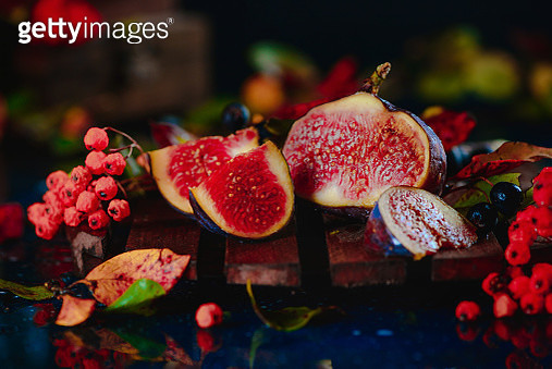 Ripe sweet figs close-up in an autumn still life with fallen leaves. Healthy mediterranean fig... - gettyimageskorea