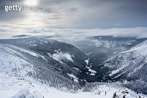 Valley between mountains covered with snow - gettyimageskorea