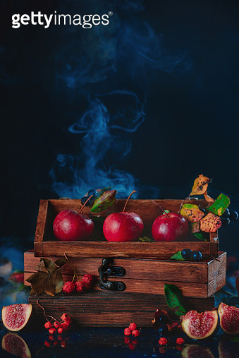 Three tiny apples in a wooden crate. Dark food photography with copy space. - gettyimageskorea