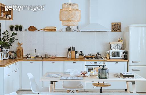 Scandinavian style cozy modern kitchen interior with a dining zone, white modern interior, everyday still llife, stay at home coronavirus quarantine, chores - gettyimageskorea