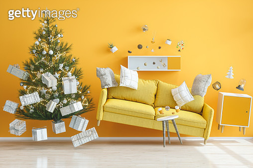 Gravity Concepts. Yellow Living Room with Christmas Tree - gettyimageskorea