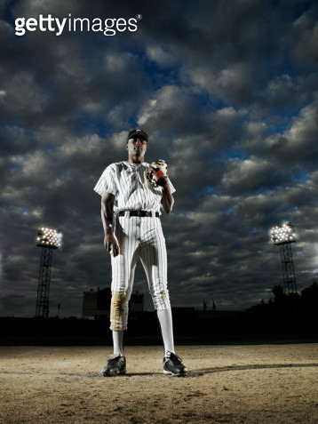 Professional baseball player standing on field - gettyimageskorea