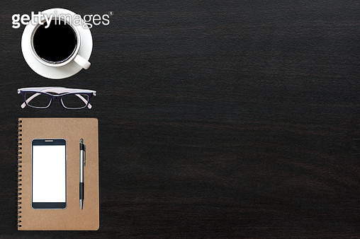 High Angle View Of Coffee Cup And Office Supplies With Smart Phone On Table - gettyimageskorea
