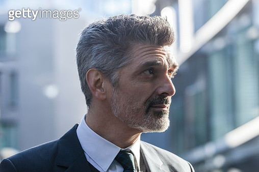 Businessman outdoors thinking - gettyimageskorea