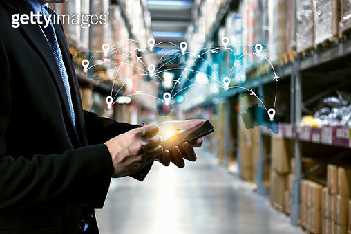 male manager hand holding tablet with AR application for check order pick time in smart factory warehouse, technology interface global partner connection for Logistic Import Export background - gettyimageskorea