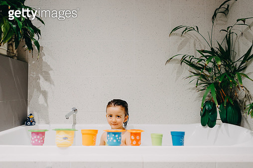 Cute Eurasian 3 year old girl playing in bath at home - gettyimageskorea