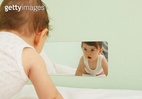 Baby looking in the mirror - gettyimageskorea