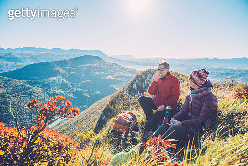 Senior Hikers Resting at Autumnal Dawn in Southern Julian Alps, Europe - gettyimageskorea