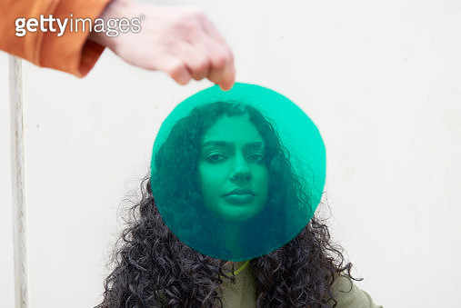 Portrait of young woman shot through green cellophane - gettyimageskorea