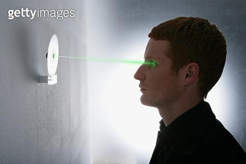 Man Undergoing Retinal Eye Scan - gettyimageskorea