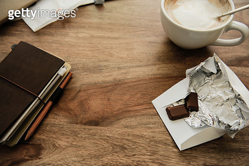 High Angle View Of Coffee And Case On Table - gettyimageskorea
