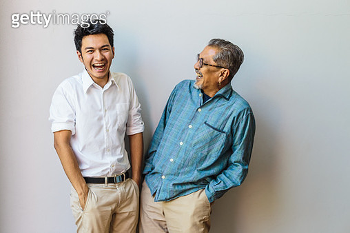 Portrait of Asian senior father and his adult son having fun together and standing on gray backgrounds - gettyimageskorea